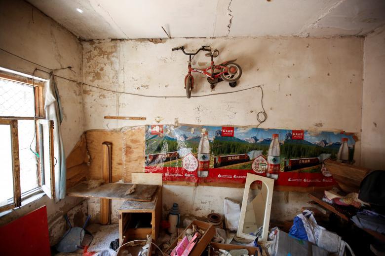 حلبیآبادهای پکن، لکهای بر چهره توسعه